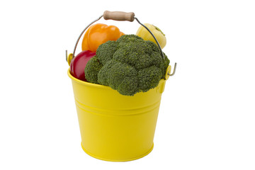 vegetables in the yellow bucket isolated