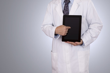 A medical professional pointing to his tablet computer.