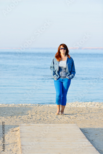 woman walking near the sea