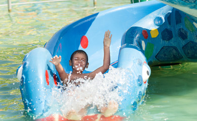 young child having fun in aqua park