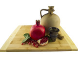 Ceramic jug, pomegranate and old metal wine cup