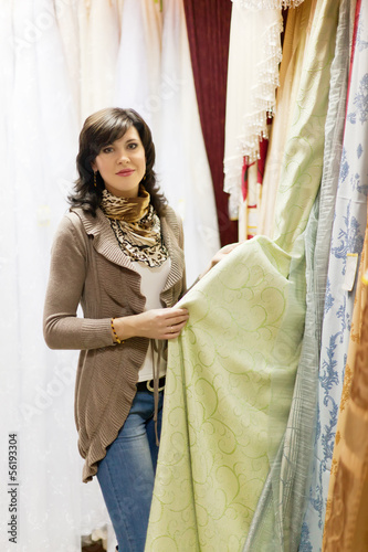 woman chooses the draperies