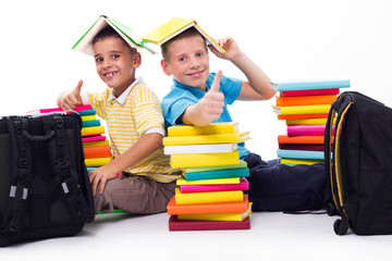 boys with piles of books