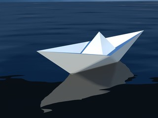origami paper sailboat sailing on blue water