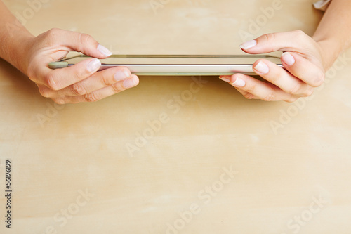 Hands using a tablet PC
