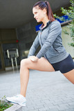 Active woman stretching her legs