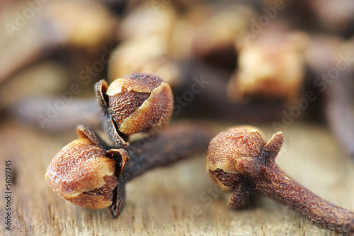 Dry clove closeup on wooden background