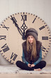 girl on a background of huge clock