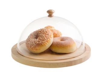 donut. donut under glass cloche