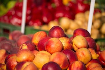 Fresh peaches on a wooden bucket