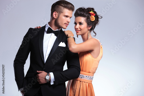 fashion couple with woman behind man