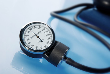Sphygmomanometer on blue background