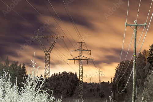 Power lines and yellow clouds at night