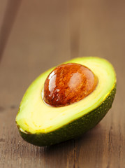 Avocado fruit on brown wooden old table