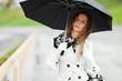 Beautiful woman with umbrella in the rain