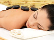 Stone massage for woman at  spa salon.