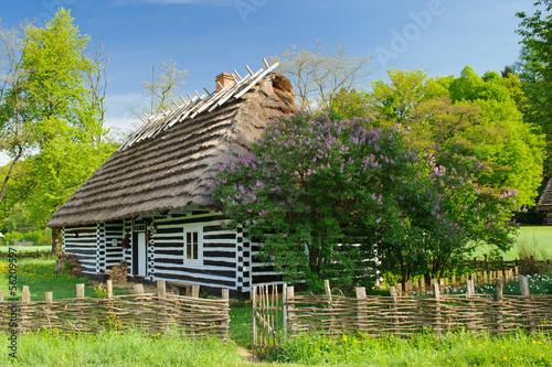 Fototapeta Polish cottage house in small village