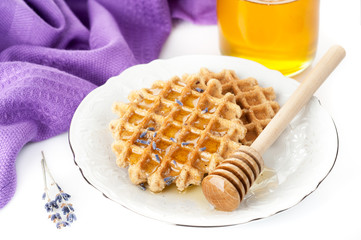 Lavender honey and Belgian waffles. Delicious dessert.