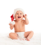 Beautiful funny baby in a Christmas hat isolated on white