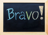 """Bravo"" word on black board."