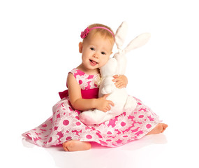 little baby girl hugging a  toy bunny rabbit isolated on white