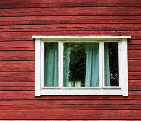 Window in a red wooden house