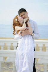 beautiful young couple in love near the sea