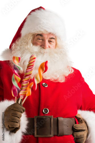 Portrait of happy Santa Claus holding candy looking at camera