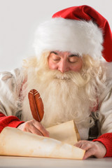 Real Santa Claus writing list of gifts or responding to children