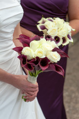 bride and bridesmaid with wedding bouquets