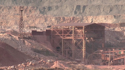 heavy machinery working at the quarry - open-pit mining