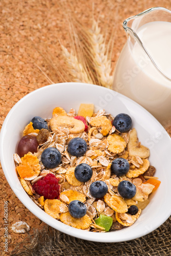 Muesli with pieces of fruit blueberries and raspberries