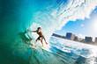 Leinwanddruck Bild - Surfer on Blue Ocean Wave in the Tube Getting Barreled