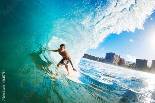 Leinwanddruck Bild Surfer on Blue Ocean Wave in the Tube Getting Barreled