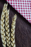 wheat and check napkin on leather