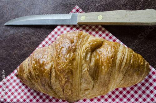 croissant and knife on a gingham nankin