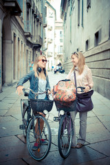 two beautiful blonde women shopping on bike