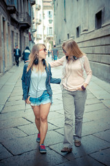 two beautiful blonde women walking and talking