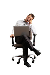 man sitting on office chair and yawning