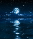 super moon and clouds in the night on sea