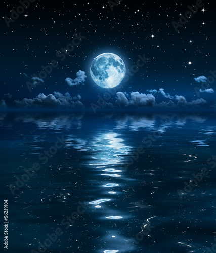 Fototapeta super moon and clouds in the night on sea