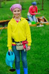 Gardening - girl helping mother in the garden