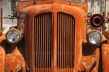 Old Orange Vinatge Fire Truck Sits Rusting in Desert Country