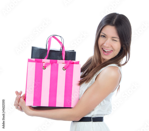 woman with shopping bags cheerful smiling and winking