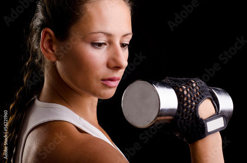 Beautiful woman exercising with dumbbells
