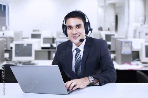Portrait of friendly customer support