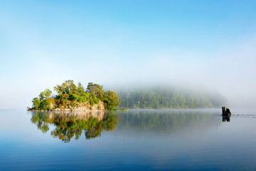 Island on foggy morning
