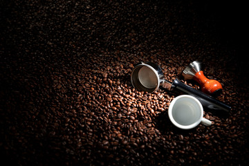 Coffee beans with portafilter, tamper and cup. business concept