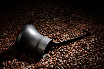 Coffee beans with cezve. Coffee business concept