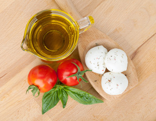 Mozzarella, olive oil, tomatoes and basil